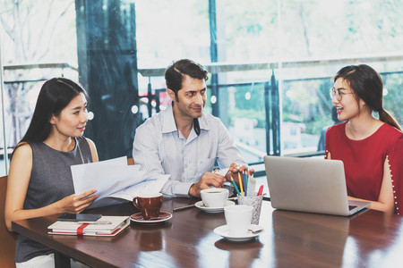 3 people: 3 people meeting in coffee shop, business casual conceptual