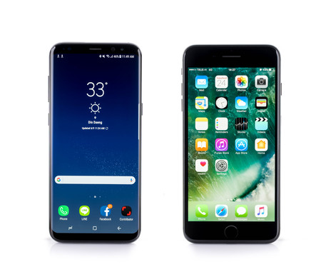 BANGKOK, THAILAND-June 9th 2017: Samsung Galaxy S8+, S8 Plus side by side comparison with Iphone7 Plus on white background Stok Fotoğraf - 83003966
