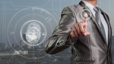 Businessman pressing on digital virtual screen, human resource management concept Foto de archivo