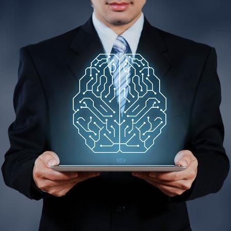 AI、人工知能の概念を示すタブレットを使用してビジネスマン 写真素材