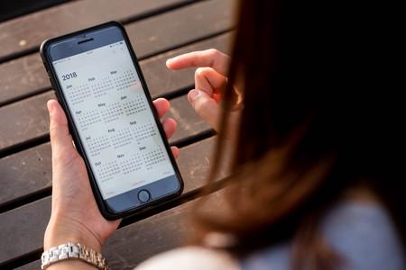 BANGKOK, THAILAND - NOVEMBER 26th, 2017: Hand of woman hold iphone 8 plus show calendar of 2018 on screen
