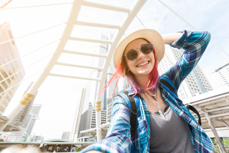 Woman westerner taking selfie during travel in city happy moment vacation Stock Photo