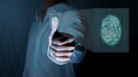 Man working on next generation of technolgoy, use finger prints to identify personality Stock Photo