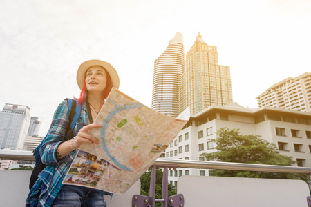 Woman westerner looking at map during city tour in the morning, Westerner tourist conceptual Stock Photo