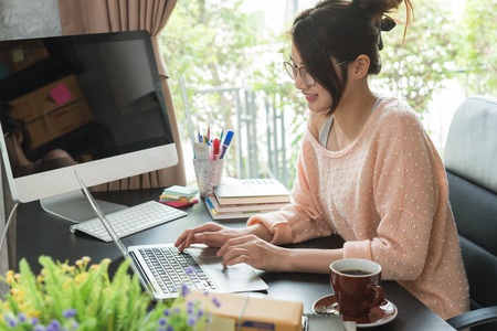 Young beautiful girl working at home, young entrepreneur conceptual