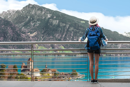 Woman westerner travel in backpack with map looking at Castle View at Visp, Switzerland