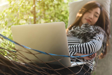 Laptop of Young woman sleeping in hammock , freelance life style conceptual, work anywhere