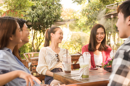 Group of friends hang out in cafe