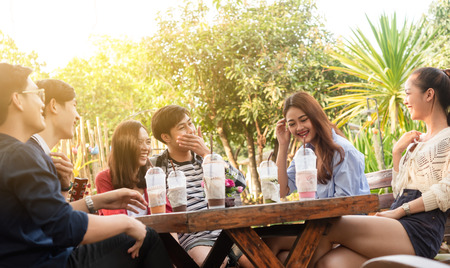 Group of friends hang out in cafe have fun together 스톡 콘텐츠
