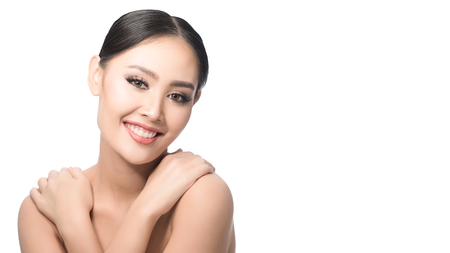 Beauty shot of young pretty asian woman with clear skin ongrey background, for skin ad and cosmetology with copy space for text insertion