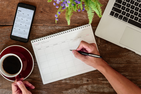 SEPTEMBER 17, 2018: Working table top with organizer for monthly planing with Iphone 8 plus use calendar application with year 2019 Stock Photo - 113347750