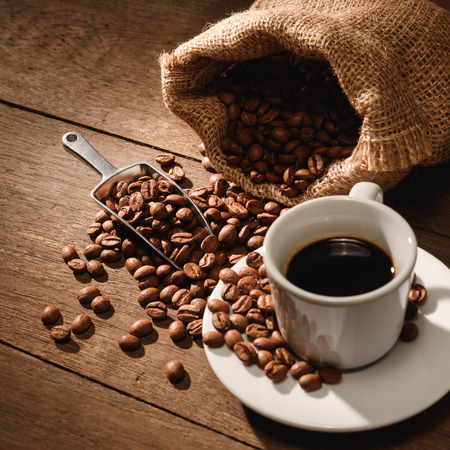 A shot of espresso with roasted coffee bean 写真素材