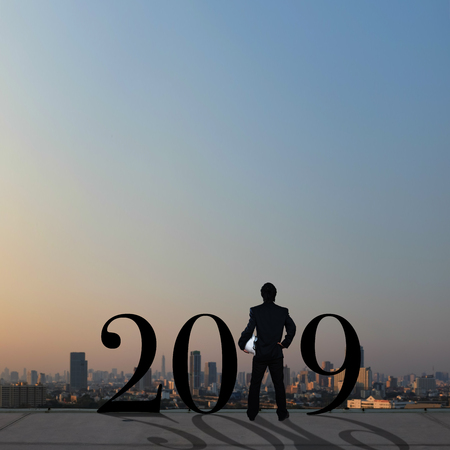 businessman stand on roof top with conceptual of year 2019