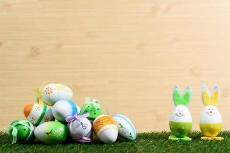 Easter decorative background on grass and wooden floor