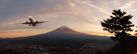 Panaroma view of Fuji-san, the highest mountain in Japan, from rope way at Lake Kawaguchiko with airplane on the sky Stock Photo