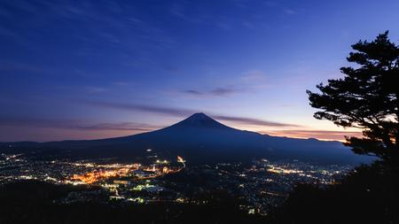 Night scene of kawaguchiko area in Yamanashi, Japan at sunset with beautiful sky and light from city Stock fotó