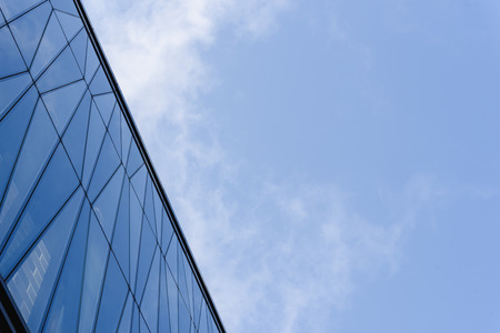 top of mirror building with sky and cloud