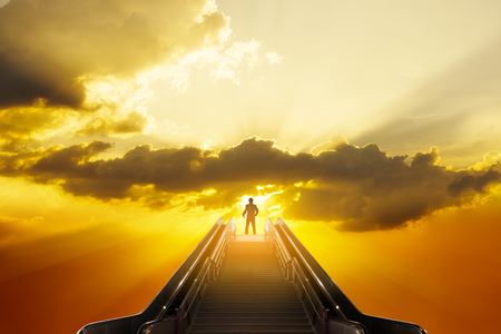 Businessman stand on top of staircase with sun light on open sky, success businessman conceptual Banco de Imagens - 121620131