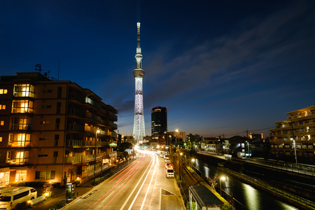 Tokyo sky tree, the tallest building in Japan with light of car run on street at sunset