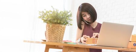 Woman small business owner, business start up conceptual, young entrepreneur work with laptop and smartphone take note Stok Fotoğraf - 126729246