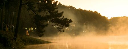 Camp site in national park in forest with lake in morning beautiful view of fog on surface water, dimension for banner Reklamní fotografie