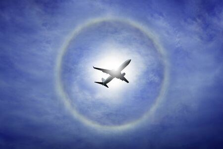 sun halo on blue sky and cloud, circle ring of rainbow around the sun, natural phenomenon from moisture in the air