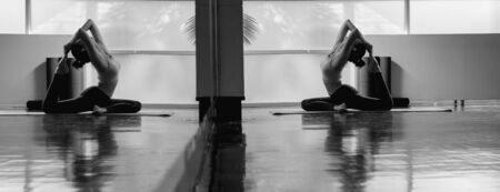 Young asian woman perform yoga training with very flexible body in black and white tone Stok Fotoğraf