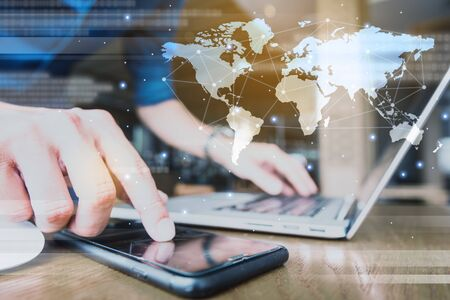 Globalization conceptual of technology use laptop and smartphone, wireless internet connection every where