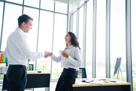 Businessman and woman shake hands agree for a new contract for both business in the future