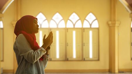portrait of young muslim woman pray in a mosque Stock Photo