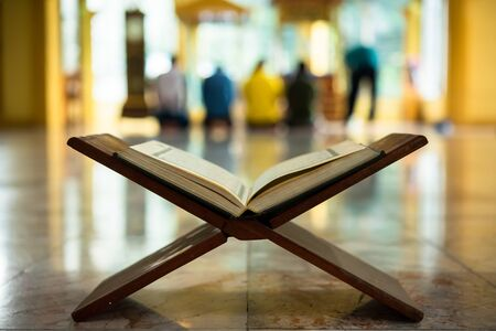 Quran, a muslim holy text book, central religious text of Islam, which Muslims believe to be a revelation from God Stock Photo
