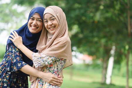 Portrait of two close friend islamic girl or sister hug each other Banco de Imagens