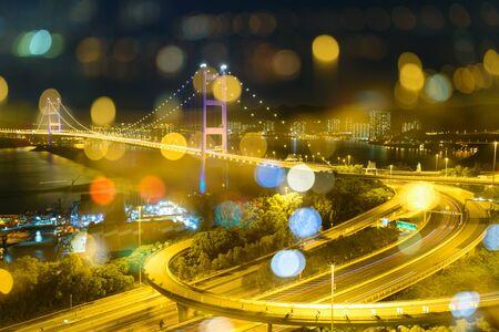 Tsing ma bridge with image overlay effect creating beautiful bokeh Stock Photo