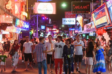 CHONBURI, THAILAND - AUGUST 17th, 2019: Walking street at night in Pattaya with night clubs, bars and restaurant, a very popular tourist site in Thailand Редакционное