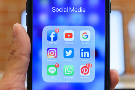 BANGKOK, THAILAND- 23th August 2019 : Hands of man use Iphone 7 plus with social media application icon of facebook, youtube, google search, instagram, twitter, linkedin, line whatsapp, and pinterest