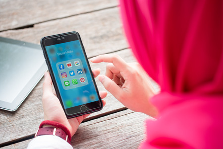 BANGKOK, THAILAND- 10th August 2019 : Hands of Islamic woman use Iphone 7 plus with social media application of facebook, youtube, google search, instagram, twitter, linked in, line whatsapp, and pinterest