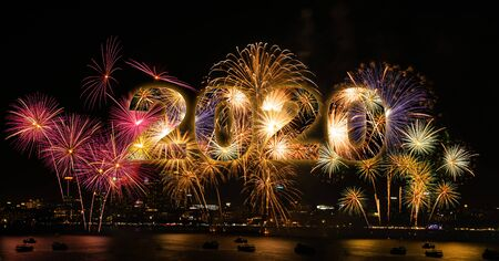 New year celebration fireworks with city in background of year 2020 版權商用圖片 - 134773871