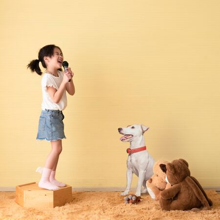 Cute little girl dream of being a super star performing concert for her pet and friend dolls