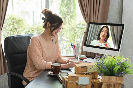 Asian woman work from home during corona virus, COVID-19 out break use laptop for teleconference with her teamates