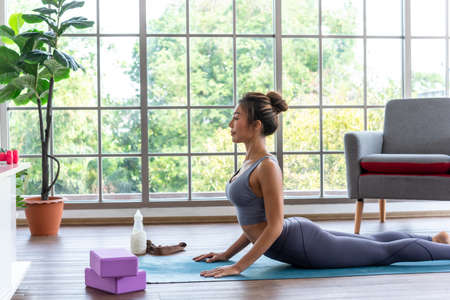 Easy yoga practise at home, stress relaxing exercise by yourself in your house, stay fit by yoga at home