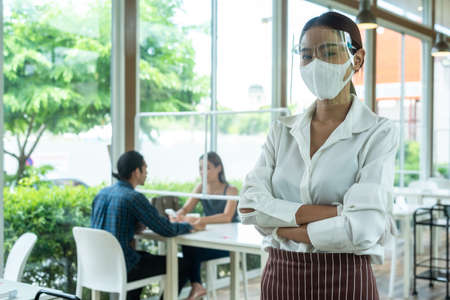 Portrait of restaurant staff wearing face shield, mask and glove in new normal conceptual