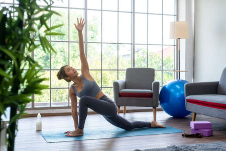 Easy yoga practise at home, stress relaxing exercise by yourself in your house, stay fit by yoga with professional yoga master as your personal trainer Banco de Imagens