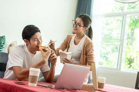Asian couple having lunch at home by order delivery food Stock fotó