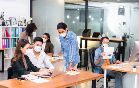 Six asian people work in office with face mask on everyone, new normal life style
