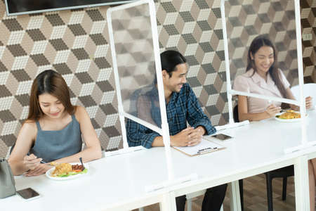 Group of friends three person meet in restaurant with new normal life style