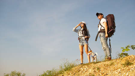 Couple backpacker and their dog on backpacking trip reach destination 版權商用圖片