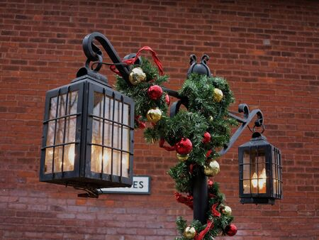 Vintage street lamp decorated for Christmas.
