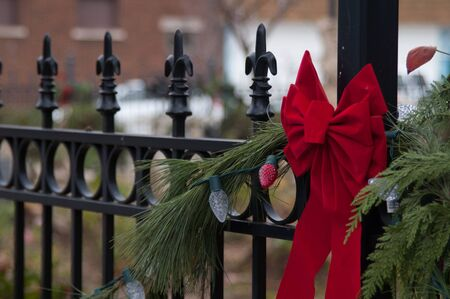 Fence decorated for Christmas. Stock Photo