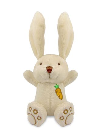 Studio shot of a isolated stuffed pale bunny toy sitting over a white background