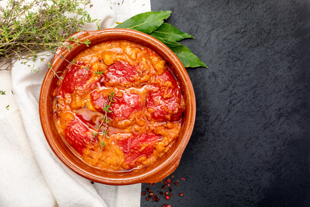 Peppers (del Piquillo) stuffed with meat or fish. Roasted red peppers and fillings made at home. Recipe of Spanish food and Mediterranean diet. With delicious sauce to spread bread. Stock Photo